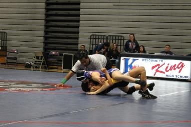 Arianna Runyan, 11, pinning her opponent